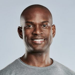 fit-handsome-smiling-man-in-gray-shirt-e1622613290172.jpg